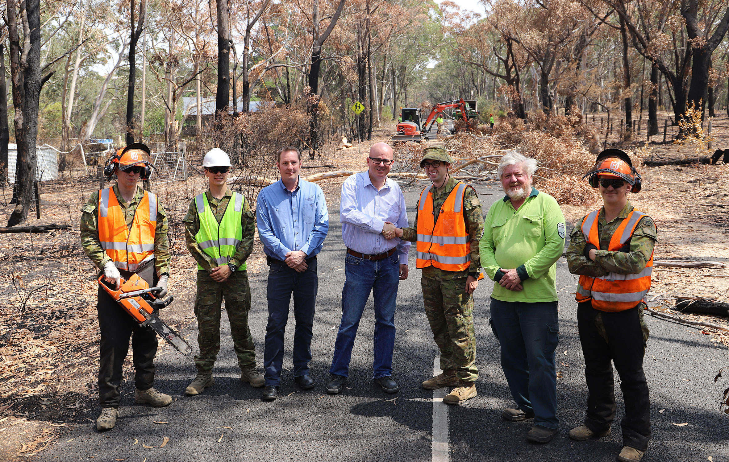 Sapper Matthew Serretta, Private Nick Kelchine, Council's emergency management program leader Peter Belshaw, Mayor Mark Greenhill, Lieutenant Edward Pym, Council's natural area management program leader Eric Mahony and Sapper Aaron La Rosa at Mount York.