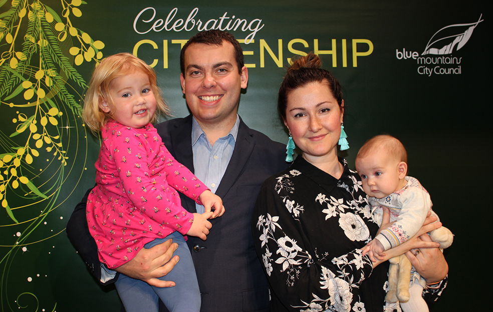 Olive, Charlotte and Poppy with Adam Vance, who received Australian citizenship.