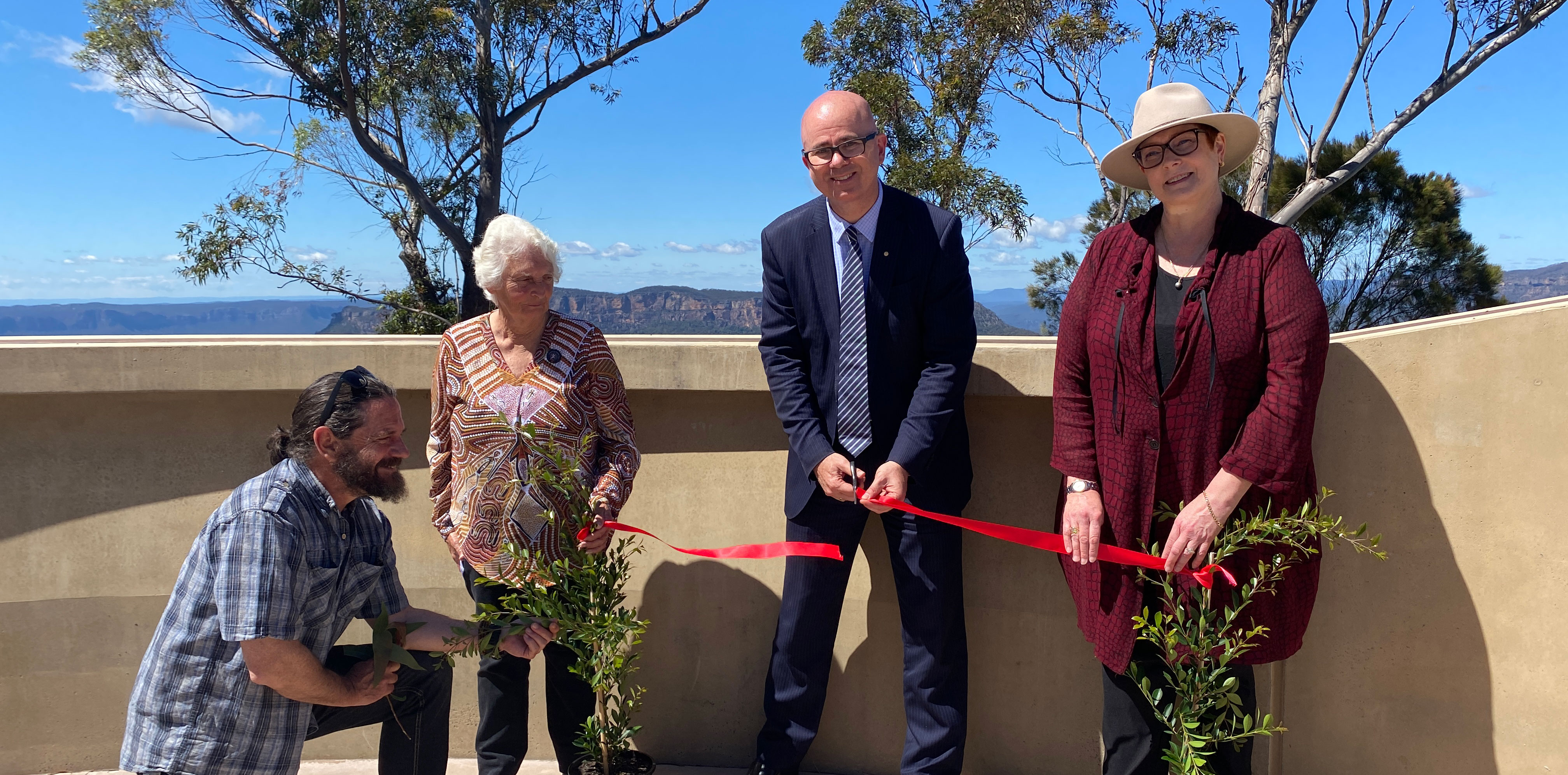Dharug man Chris Tobin, Gundungurra Elder Aunty Sharyn Halls, Mayor Mark Greenhill and Senator Marise Payne official open the new Gathering Place at Echo Point.