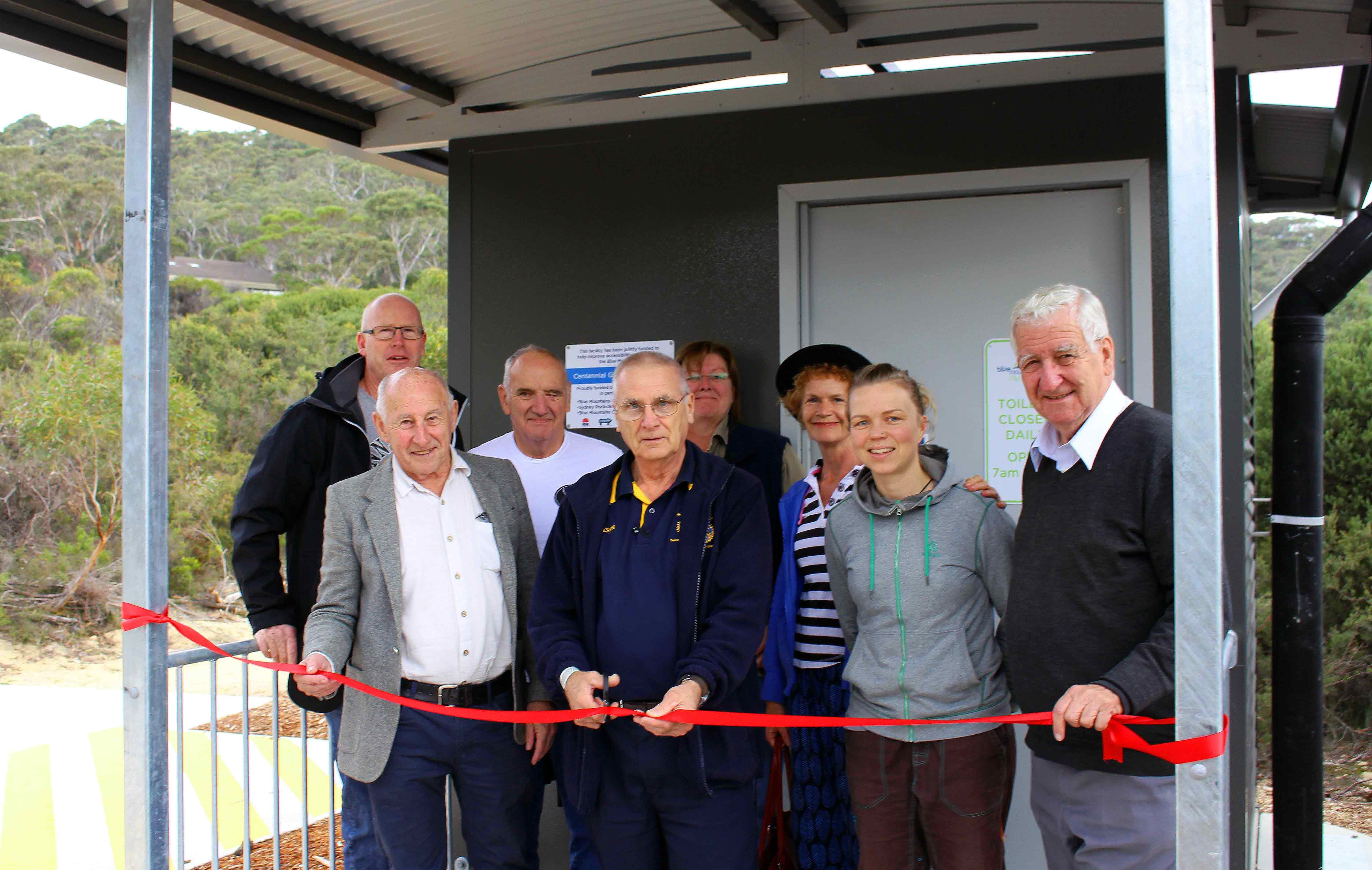 Loo with a view – The new toilet is now open at Centennial Glen climbing site. Blue Mountains Cragcare Founder Damien Taylor, Cr Don McGregor, Sydney Rock Climbing Club President Andrew Lishmund, Deputy Mayor Cr Chris Van der Kley, Council Natural Areas Management Officer Trish Kidd, Cr Kerry Brown, Cragcare volunteer coordinator Katariina Rahikainen and Cr Kevin Schreiber celebrate the opening
