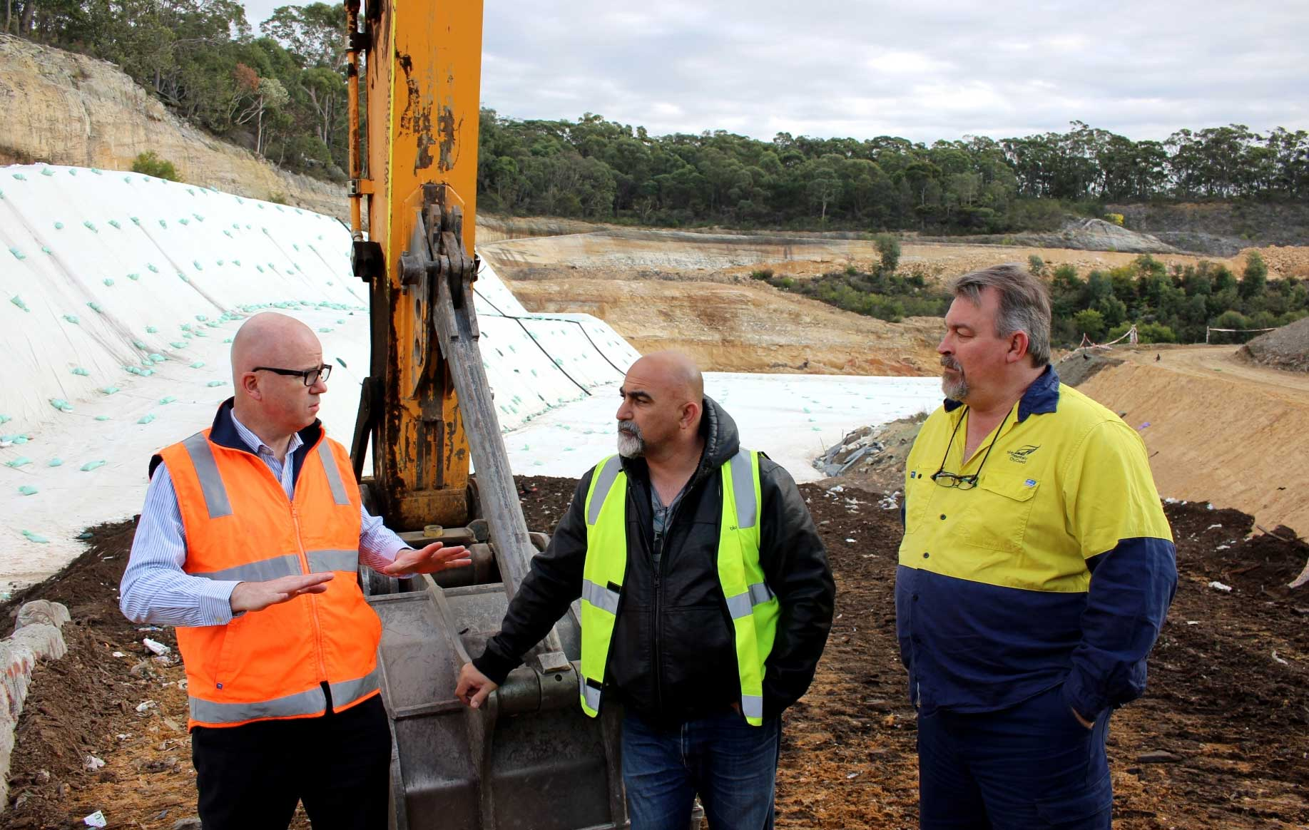 Mayor, Cr Mark Greenhill, inspects the extension of Blaxland landfill cell with Council's waste management staff. Blue Mountains has reduced waste to landfill by 50% since 2003, an impressive and uncommon trend in Australia.