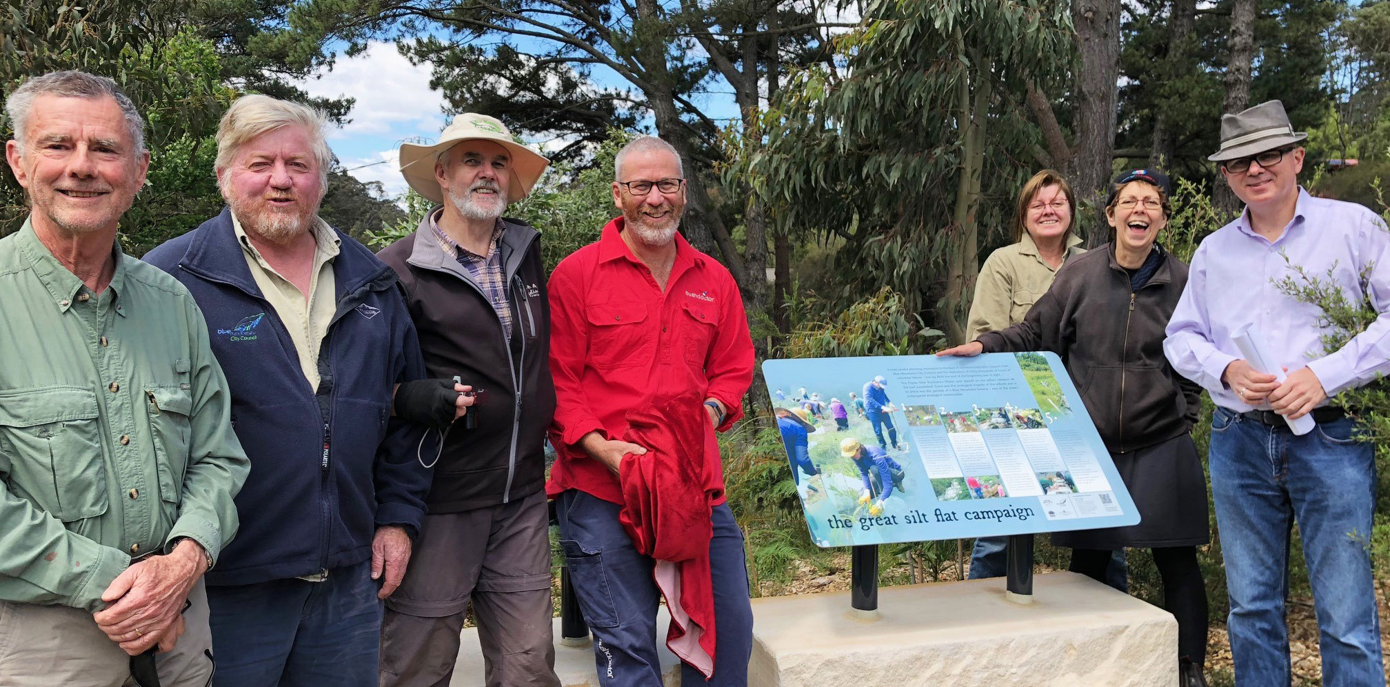 Mayor, Cr Mark Greenhill (far right) congratulates the Popes Glen Bushcare Group and supporters for completing an ambitious environmental restoration project over a six year period.