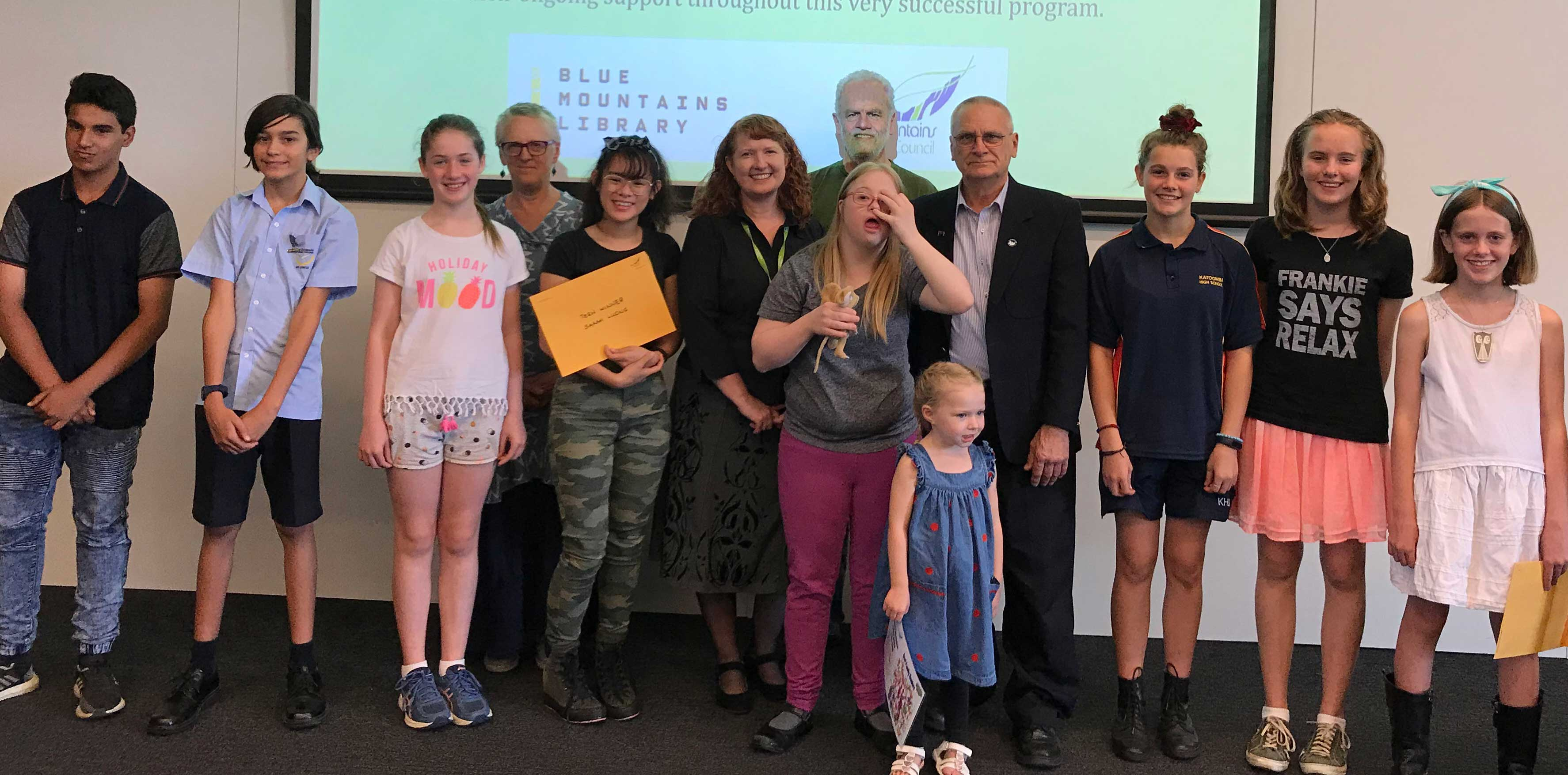 Summer Reading Challenge winners and sponsors - Syed Ahmed, Luca Penserini, Abigail Dickens, Annie Sharkey from Turning Page, Sarah Luong, Vicki Edmunds from Blue Mountains City Council, Amy Grieves, Alan Crooks from Turning Page, Emma Glenfield, Deputy Mayor Chris Van Der Kley, Ella-Beth Bonny, Emma Cranby and Madeline Brett-Hall.