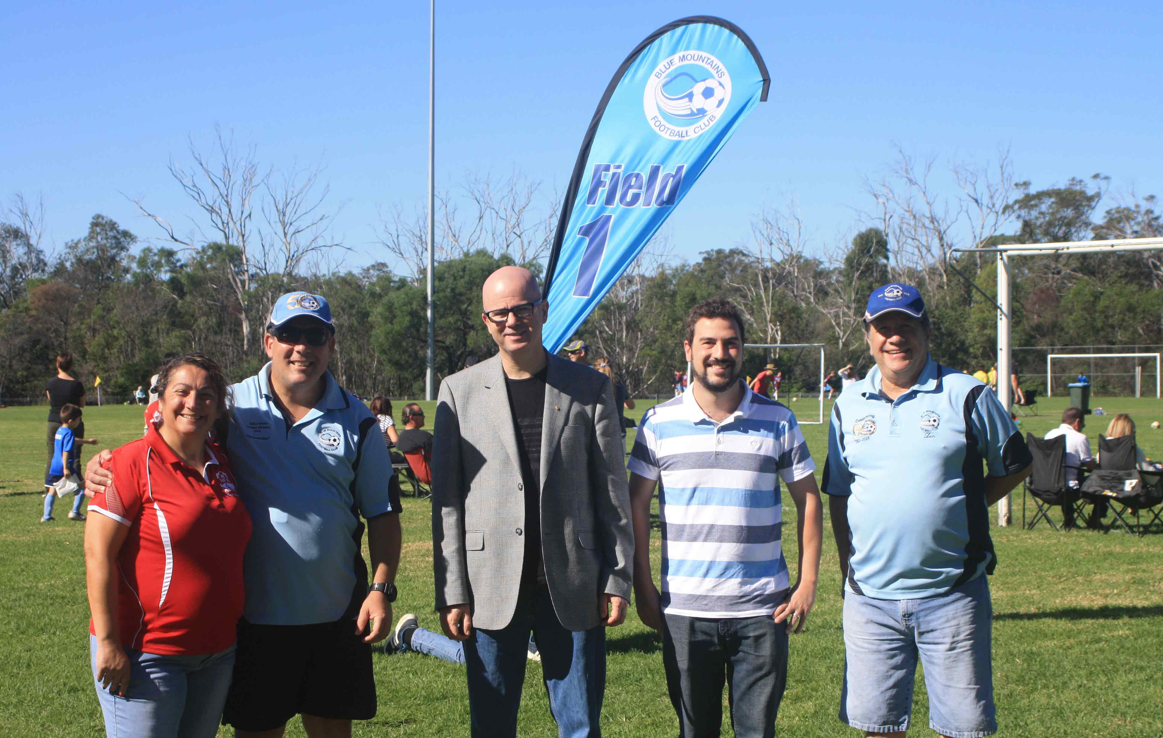 Welcome back to Knapsack: Mayor and Ward 4 Councillor, Mark Greenhill with Cr Brendan Christie and Fran Refalo (President, Nepean Football Association), David Smith & Len Bowman (President & Treasurer, Blue Mountains Football Club) open the winter sports season after a $460,000 irrigation project  to improve the playing surface of the popular sportsground.